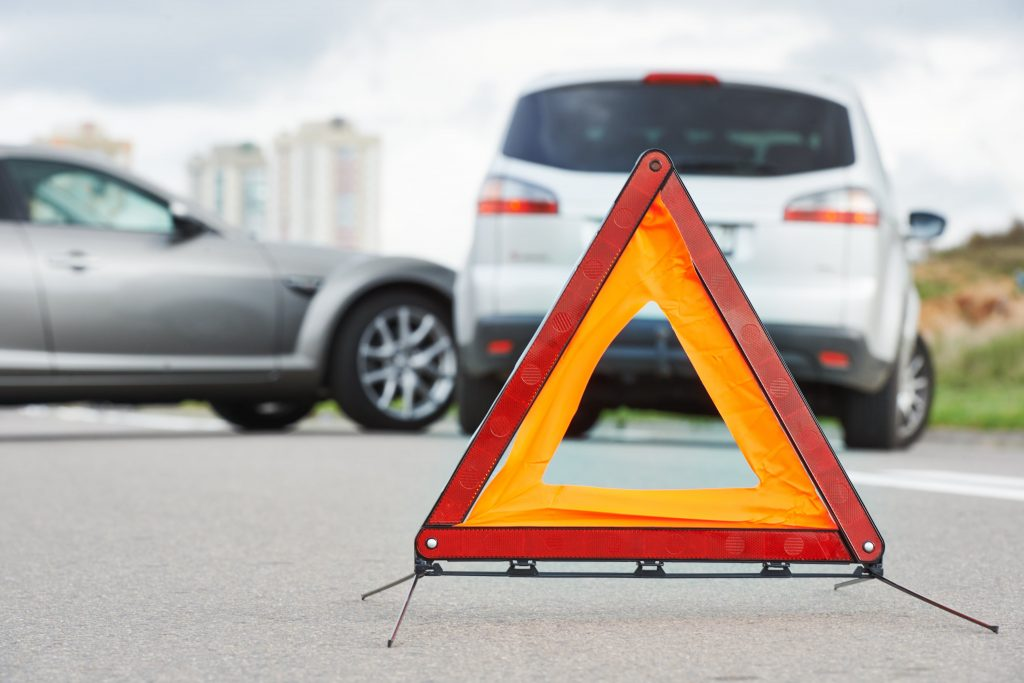 Two Cars in Road Accident with Warning Triangle